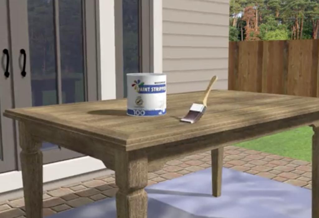 Applica uno sverniciatore sul tavolo di legno da riverniciare